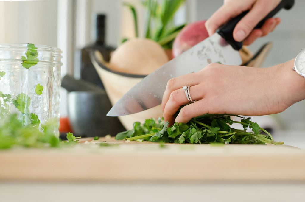 preparing herbs to save money on groceries